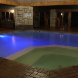 Indoor Heated Pool at Night with Hot Tub Jacuzzi